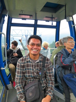 during the ropeway cable ride, with fellow tourists in the tour