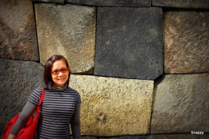 posing in one of the stone walls in the gardens