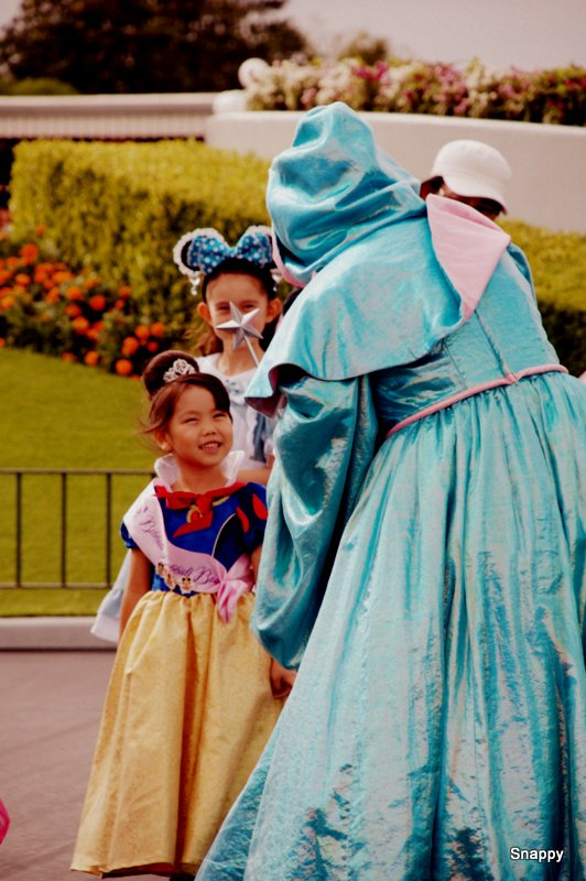 happy child talking to fairy godmother
