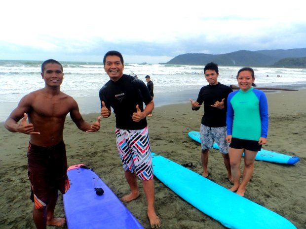 Getting familiar and ready with our surfboards and instructor Kuya Rommel